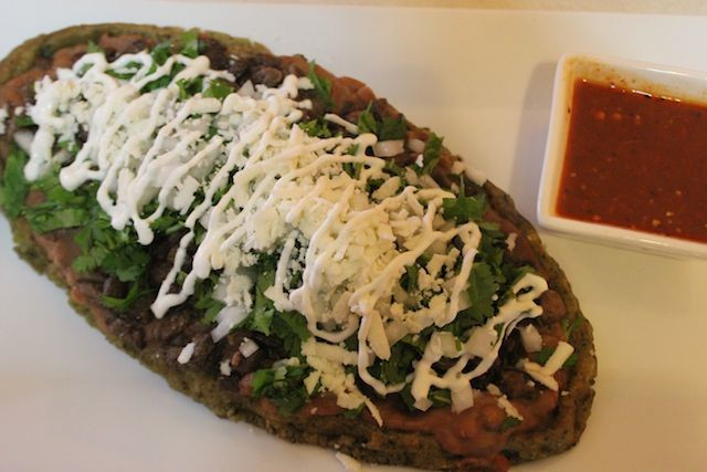 A huarache from Mexcla, with house-made salsa on the side. - PHOTO BY SARAH FENSKE