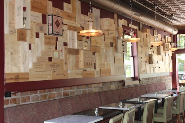 Wine crates form the artwork near the front of the eatery. - PHOTO BY SARAH FENSKE