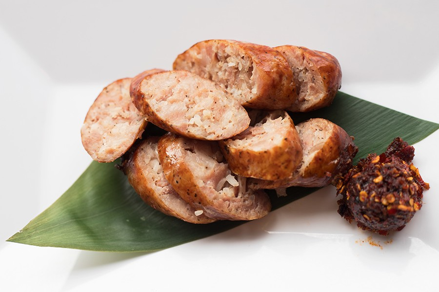 Lao sausage comes with a side of spicy chile paste. - MABEL SUEN