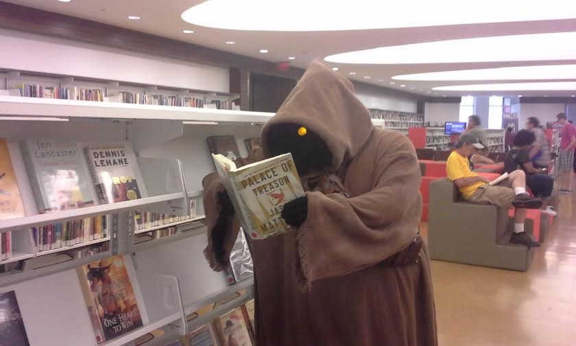 A jawa caught up on some light reading at last year's Comic Con. - RIVA STEWART