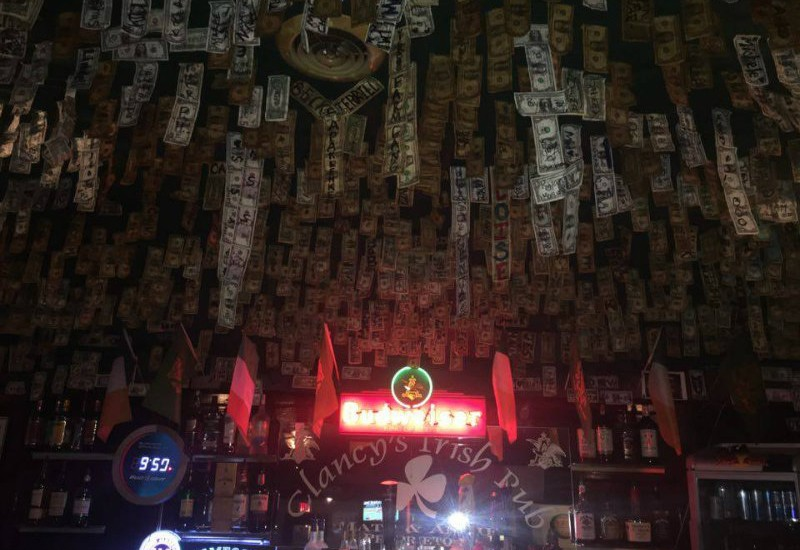 """""""A year of luck for a buck""""? Try Clancy's ceiling. - PHOTO BY CHERYL BAEHR"""