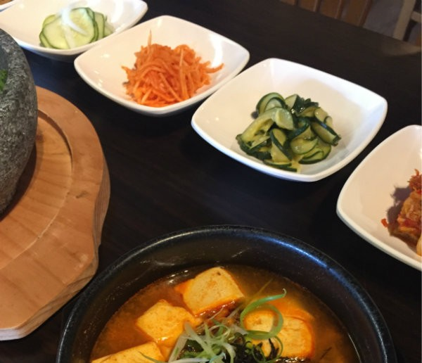 Banchan, including pickles and kimchi, are offered with your meal in the classic Korean style. - PHOTO BY EMILY MCCARTER