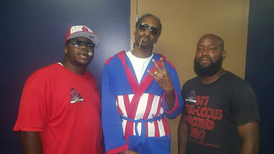 BJ's owner Bernie Lee Gray Jr. (left) and chef Kenneth Gregory II (right) with Snoop Dizzle himself. - PHOTO COURTESY OF BJ'S GUL-LICIOUS BACKYARD BBQ