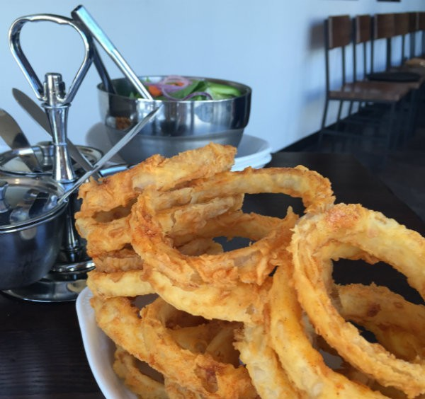 Onion rings are a house specialty. - PHOTO BY EMILY MCCARTER