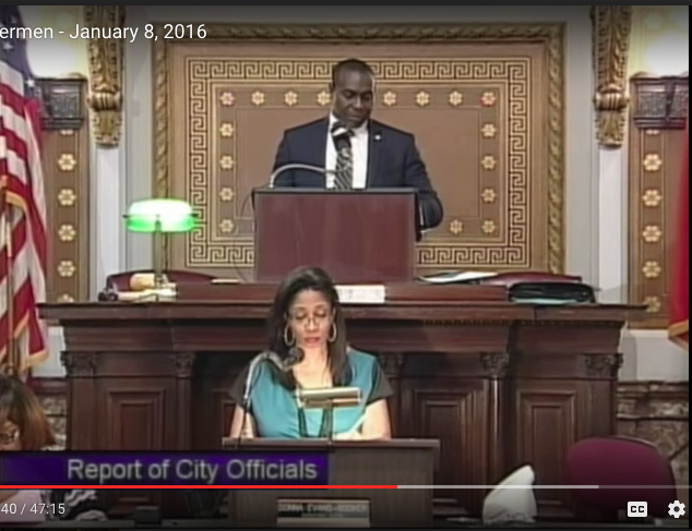 A city video captured President Lewis Reed being interrupted by protesters raising their voices in song. - IMAGE VIA YOUTUBE