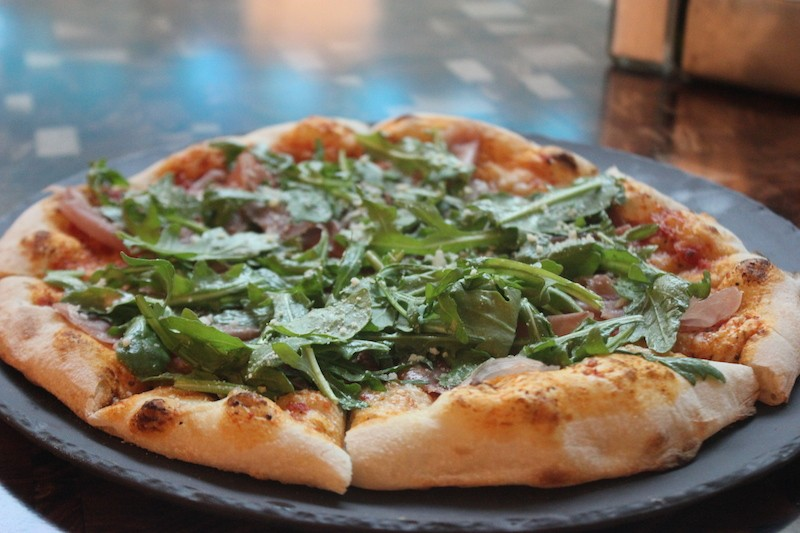 The prosciutto e arugula pie. - PHOTO BY SARAH FENSKE