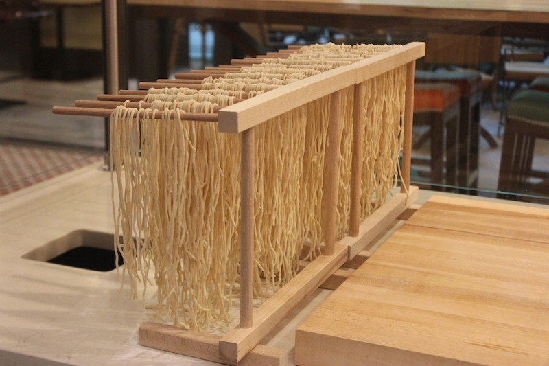 House-made pasta dries on its rack. - PHOTO BY SARAH FENSKE