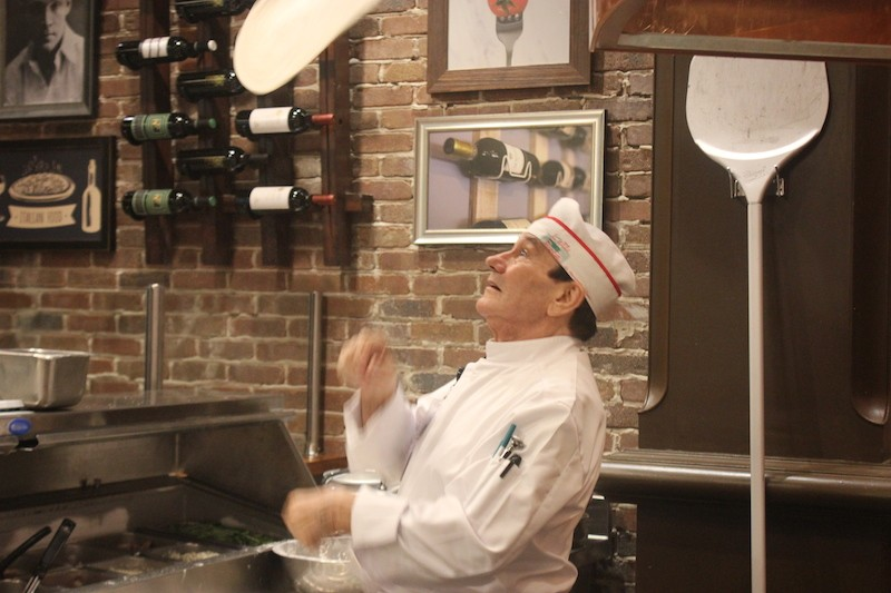 Frank Bongiovanni, a cook at Cibare, gives the pizza dough a workout. - PHOTO BY SARAH FENSKE