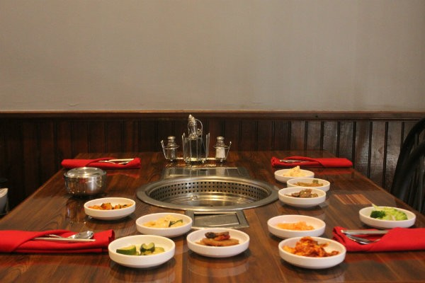 A table at Wudon filled with banchan, or small side dishes like different types of kimchi. - CHERYL BAEHR