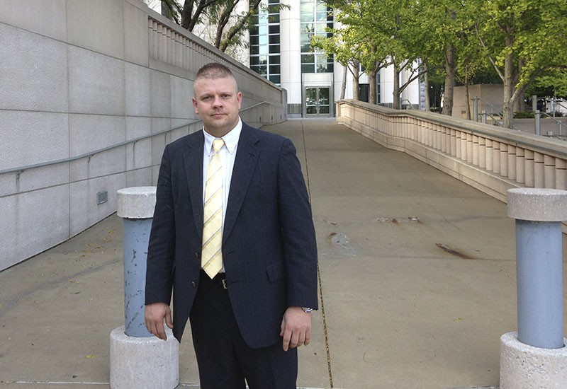 Ex-Pine Lawn Lt. Steven Blakeney leaves the federal courthouse in St. Louis on October 5. - PHOTO BY DOYLE MURPHY