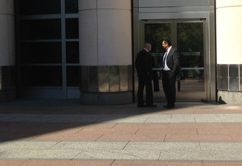 Steven Blakeney (left) speaks with longtime friend Lawrence Fleming on October 5 outside of the federal courthouse in St. Louis. - PHOTO BY DOYLE MURPHY