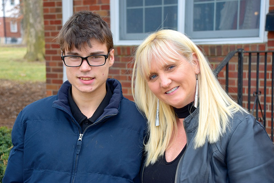 Austin and his mother, Laurie Calzada, outside their home in Brentwood. - DOYLE MURPHY