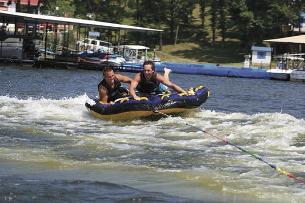 Brandon Ellingson (left, with friend Brody Baumann) at the Lake of the Ozarks in 2012, two years before his tragic drowning death. - COURTESY BRODY BAUMANN