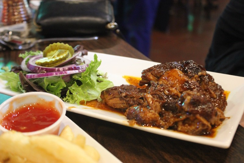 The pork steak comes with a choice of two sides. - PHOTO BY SARAH FENSKE