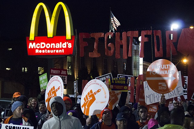 Protesters converged on a McDonald's on Hampton Avenue Tuesday evening. - PHOTO BY DANNY WICENTOWSKI