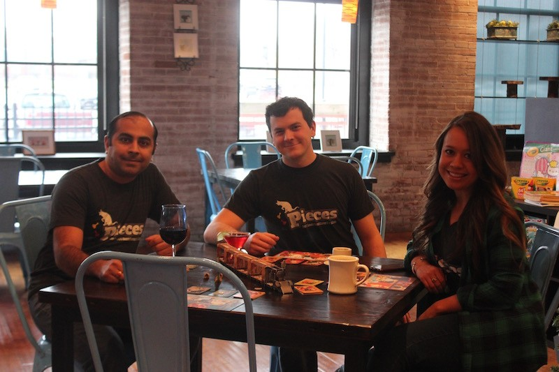 Ameet Rawal and James and Laura Lettau. - PHOTO BY SARAH FENSKE