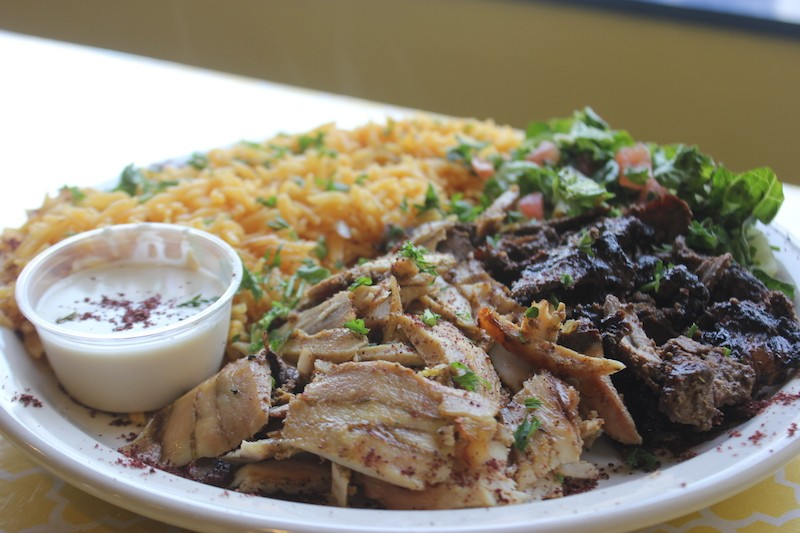 The mix shawarma and rice, a platter that also comes with a small salad and tahini sauce. - PHOTO BY SARAH FENSKE