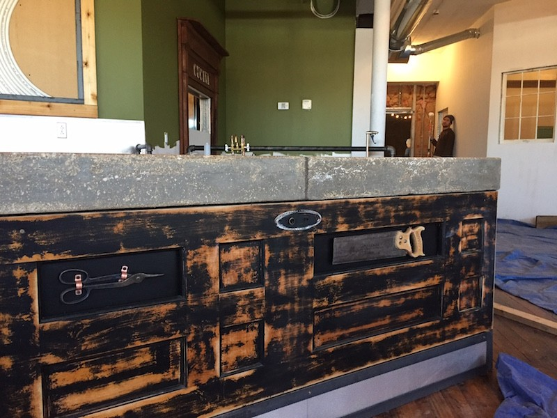 Century-old doors, and Hanneke Hardware tools, give the coffee bar visual appeal. - PHOTO BY SARAH FENSKE