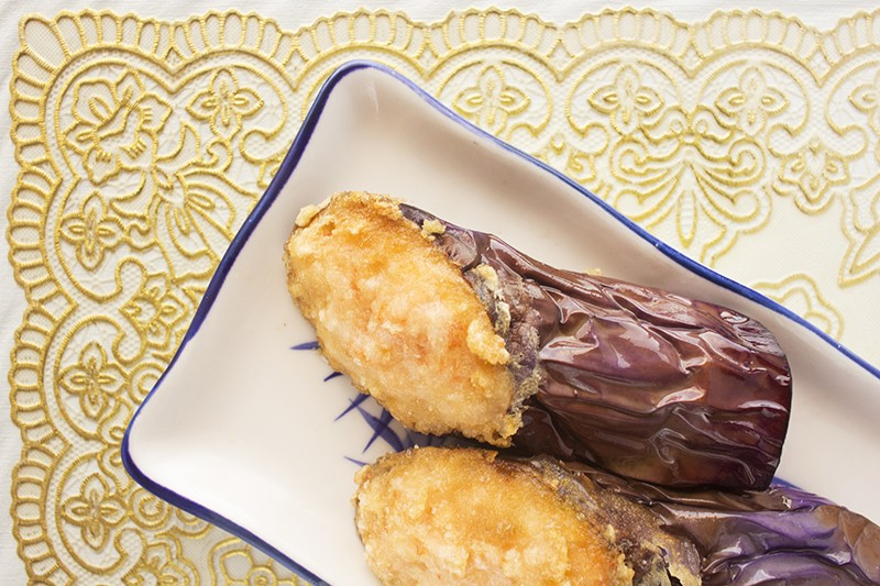 Shrimp-stuffed eggplant: Slices of eggplant, stuffed with fresh shrimp paste, rolled up and glazed with a savory sauce. - PHOTO BY MABEL SUEN