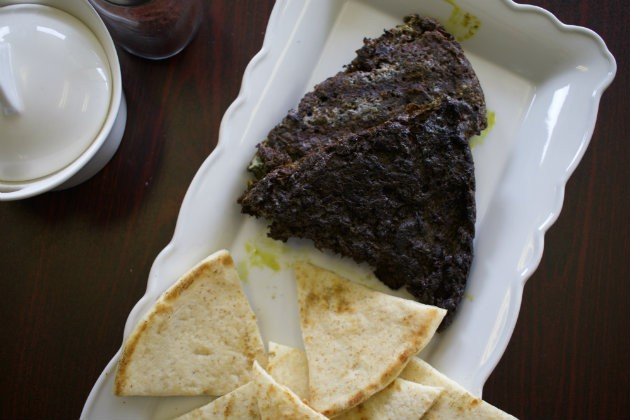 The traditional Persian dish kookoo is finished on the grill to give it a crispy texture. - CHERYL BAEHR