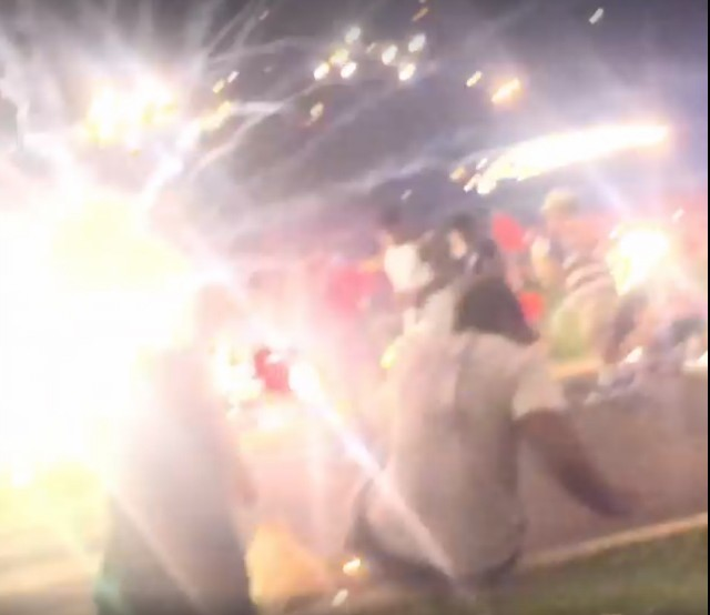 A mortar shell explodes in front of a Webster Groves crowd, captured on video. - FACEBOOK/BRIAN HARDESTY