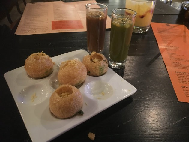 Golgappa, a popular Indian street food, filled with potatoes and chutney. - CHERYL BAEHR