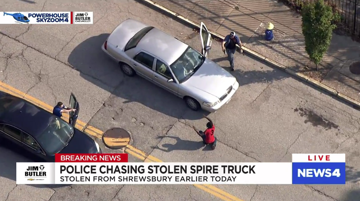 A KMOV news helicopter recorded the man as he surrendered to police. - KMOV SCREENSHOT