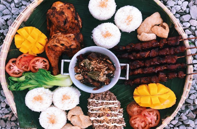 A selection of the Filipino street-food eats at the Fattened Caf pop-up. - COURTESY DARREN YOUNG AND CHARLENE LOPEZ-YOUNG