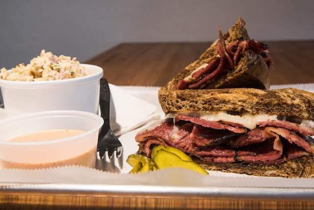 The pastrami sandwich with a side of potato salad. - TRENTON ALMGREN-DAVIS