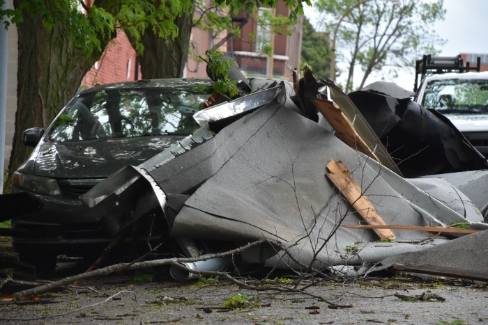 Debris from a roof landed against a car on Indiana Avenue during last night's storm. - DOYLE MURPHY