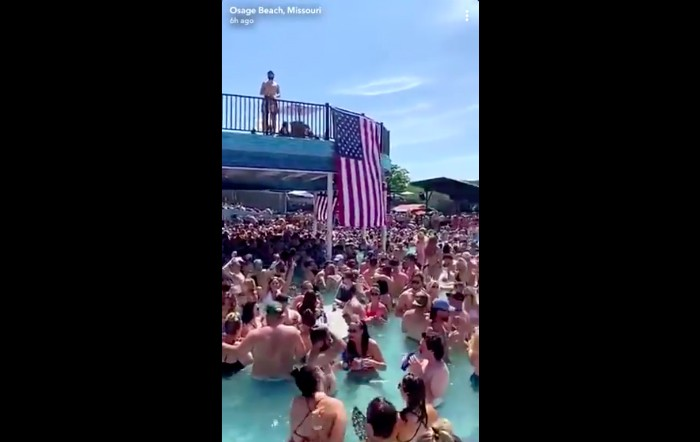 St. Louis County issued a travel advisory after videos (screengrab posted  above) showed crowds of people partying at Lake of the Ozarks bars. - SCREENGRAB VIA TWITTER