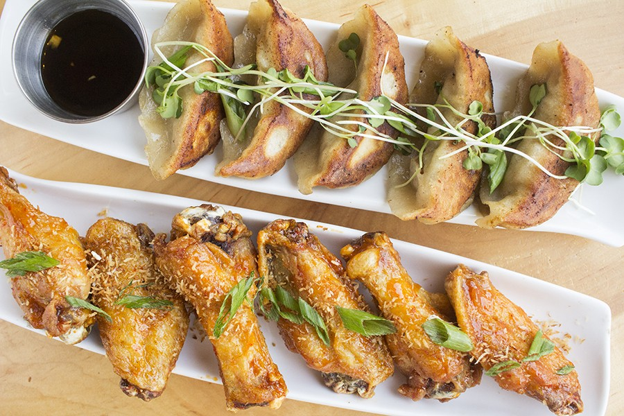 Pan-seared duck dumplings and ginger-coconut chicken wings. - PHOTO BY MABEL SUEN