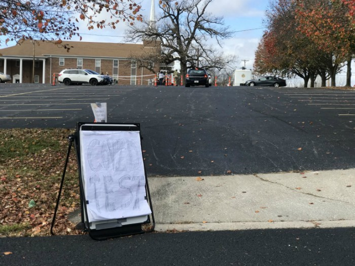 A sign marks the entrance to a drive-through COVID test site at Memorial Baptist Church in Columbia, Missouri on Monday, Nov. 9. - TESSA WEINBERG/MISSOURI INDEPENDENT