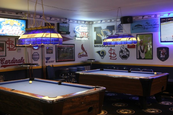 Bluenote's hockey themes pool tables. - CHERYL BAEHR