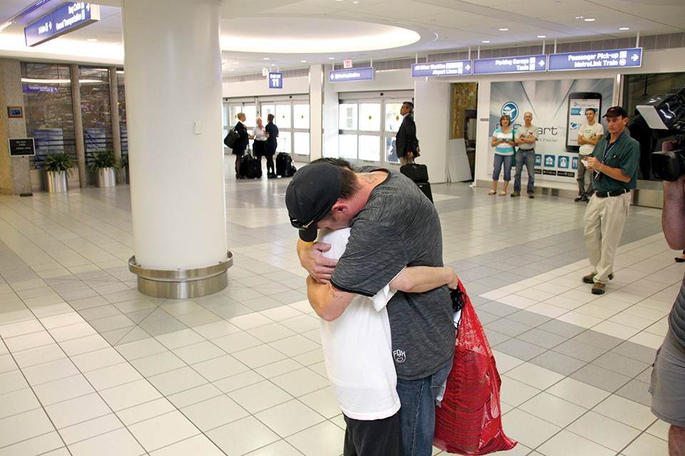 Separated for more than five months, Dow and Justin embrace in Lambert airport, reunited thanks to a last-minute reversal of her deportation. - RENEE BRONAUGH/PARK HILLS DAILY JOURNAL