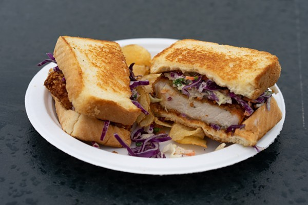 Sandos are served on toasted white bread with slaw and potato chips, which come in handy for scooping up runaway slaw. - HOLDEN HINDES