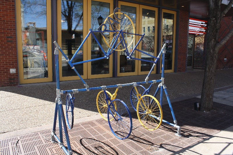 A BoomerRacks bike rack in front of the Regional Arts Commission. - PHOTO BY BILL LOELLKE