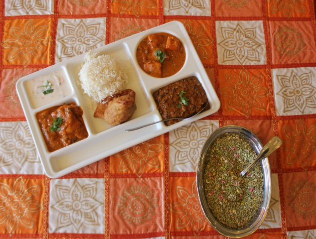 A selection of chicken tikka masala, chicken curry, lentil stew and raita. - CHERYL BAEHR