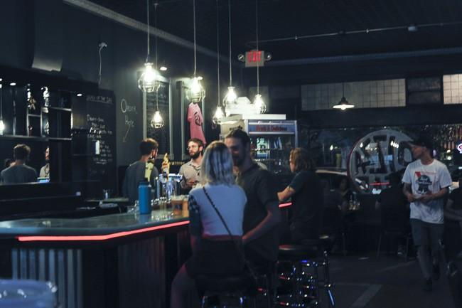 The place has a dark, bar-like feeling — but no hard liquor. - PHOTO BY KELLY GLUECK
