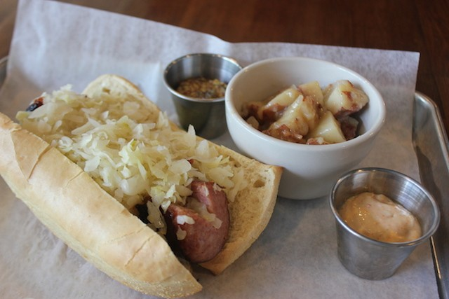 Some sandwiches, like this kielbasa hoagie, are served with a side of German potato salad — recipe courtesy of Ryan Reel's mother. - PHOTO BY SARAH FENSKE
