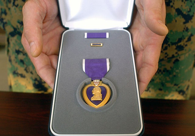A St. Louis man posed as a Purple Heart recipient to scam his Airbnb host. - IMAGE VIA U.S. MARINE CORPS