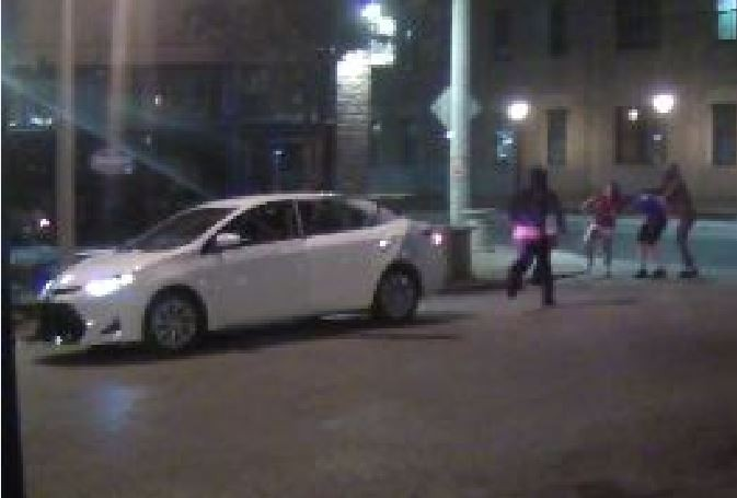 Suspects in a Delmar Loop robbery were recorded on surveillance video along with their getaway car. - IMAGE VIA ST. LOUIS METROPOLITAN POLICE