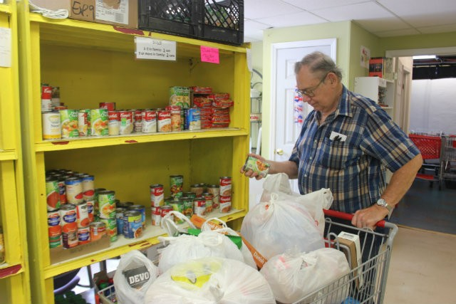 Tom Roussin (pictured) is a one-year client of Ritenour Co-Care Food Pantry and depends on the money he saves to pay for his rent and electricity. A typical cart at the food pantry is worth about $200. - PHOTO BY SABRINA MEDLER