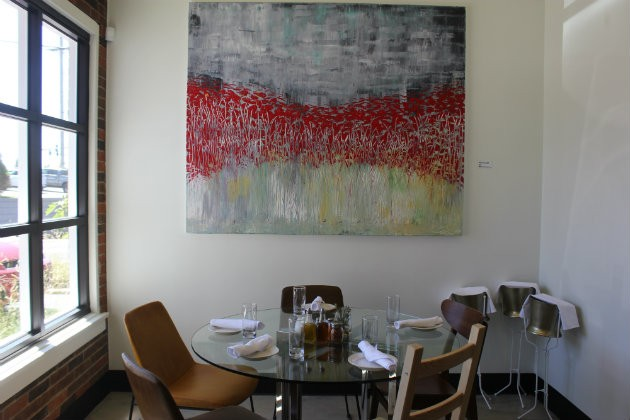 Artwork by co-owner Ted Collier decorates the space. - CHERYL BAEHR