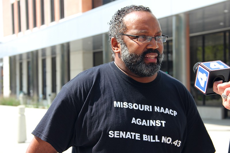 NAACP president Nimrod Chapel at today's press conference. His t-shirt references a new Missouri law increasing the burden for proving workplace discrimination. - PHOTO BY DANNY WICENTOWSKI