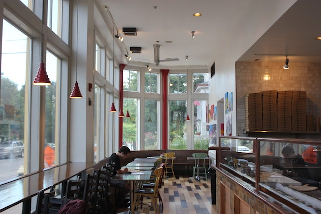 Cafe Piazza Now has wide windows overlooking Lemp Avenue and a view of the glassed-in kitchen. - PHOTO BY SARAH FENSKE