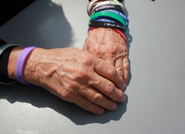 Pat Maisch wears bracelets to remember victims of gun violence. - PHOTO BY DOYLE MURPHY