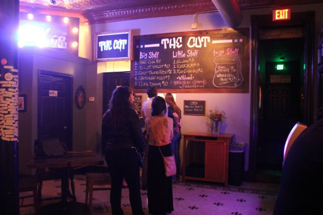 Guests line up for food at a window in the back of the Fortune Teller Bar. - CHERYL BAEHR