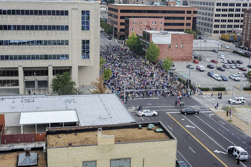 Hundreds of people massed outside the St. Louis Metropolitan Police headquarters on the afternoon of Sunday, September 17. - PHOTO BY KELLY GLUECK