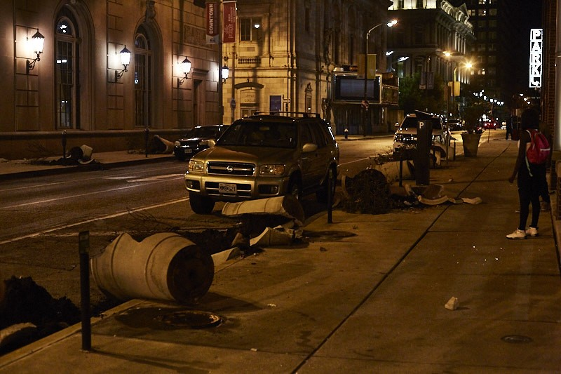 Destruction in downtown St. Louis on Sunday, September 17, included smashed planters and broken windows. - PHOTO BY THEO WELLING